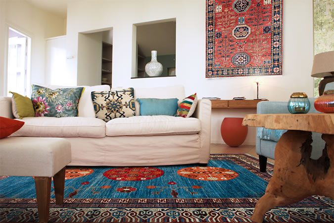 Rugs from The Magic Carpet decorate a living room.