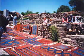 Dobag Weavers Displaying Their Rugs