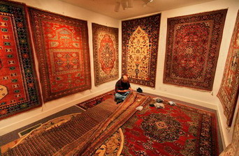 Rudy repairing rugs in The Magic Carpet.