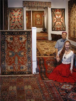 Paul and Eileen Jorgensen in surrounded by hand made oriental rugs.