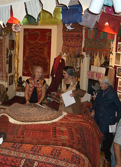 Eileen Jorgensen hard at work sharing the beauty of Oriental rugs.